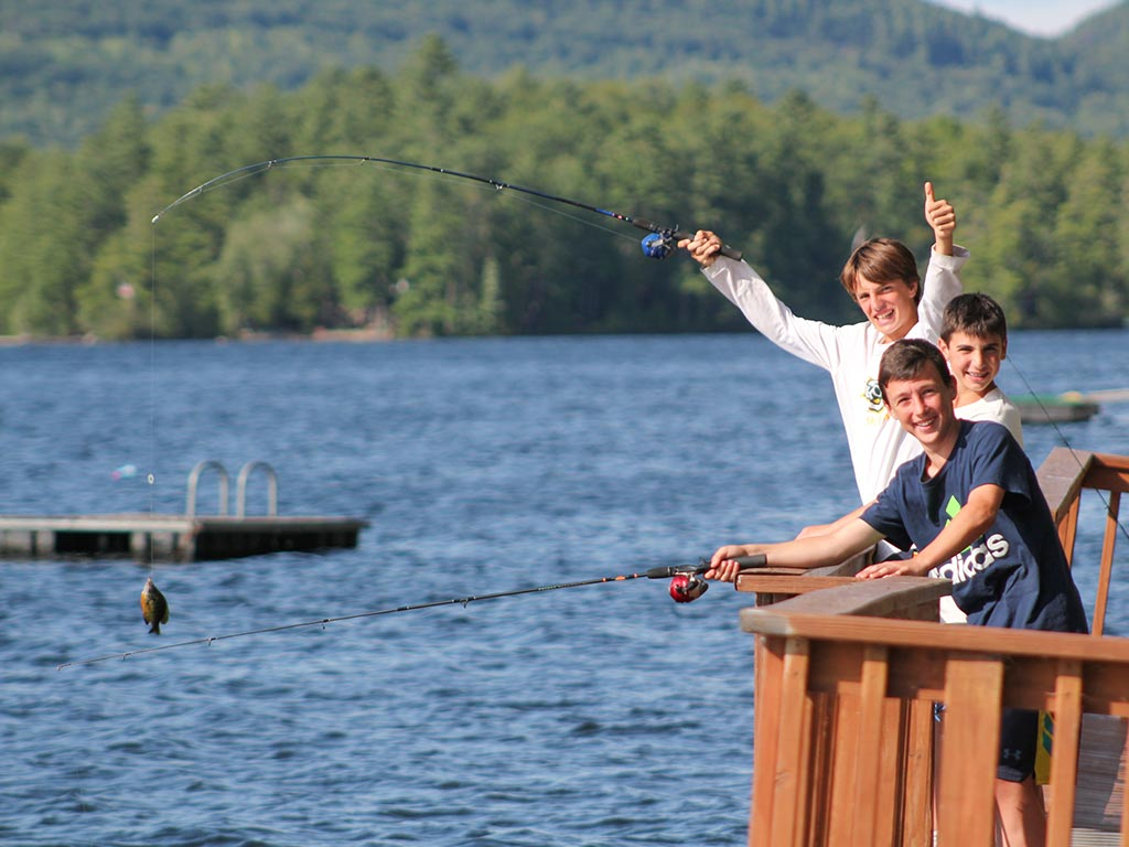 Fishing off the dock at summer camp