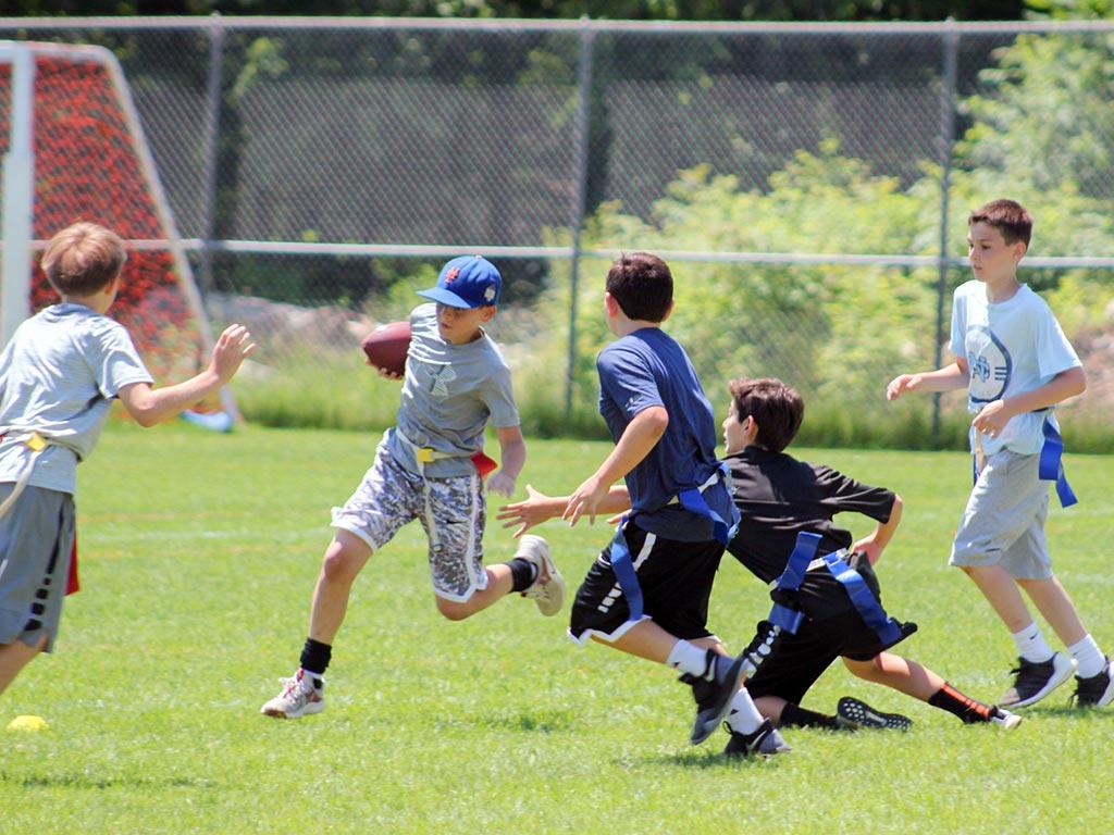 Flag football at summer sports camp