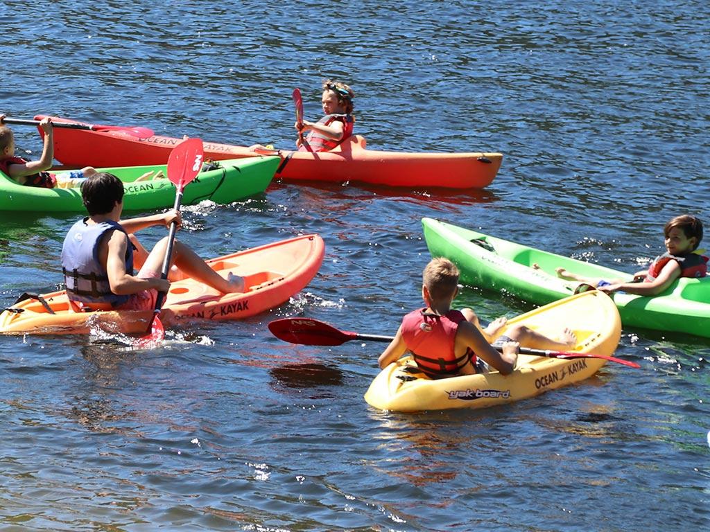 Kayaking on the lake at boys sleepaway camp